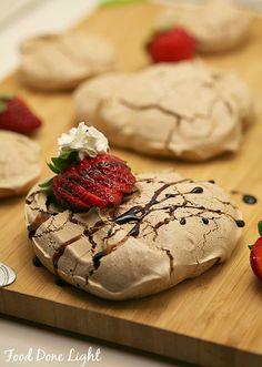 Dark Chocolate Pavlova with Wine Soaked Strawberries and Wine Reduction