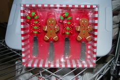 """Gingerbread Man & Candy Cane Spreaders  set of 4 (2 each of 2 designs) by Main Street Collection. Each blade engraved w/ """"M S C Mainstreet Collection."""" Set include 2 gingerbread man w/ red and green buttons/neck scarf; and two red and green candy canes w/ red polka-dotted bows attached on the middle."""