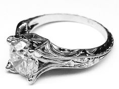 Vintage Petite Hand Engraved White Gold Filigree Engagement Ring and add 1.5 ct. round diamond in the center.