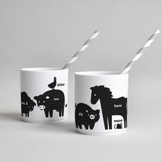 Buddy and Bear white hard plastic drinking vessel with animal print in black as children's tableware, toothpaste cups or for picnics.