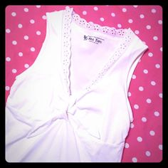 Victoria's Secret tank with built in bra White tank from Victoria's Secret with a built in shelf bra. Cute eyelet trim and tie front detail make this perfect for the beach! Worn maybe once - no discoloration or pilling. No size listed on tag but fits like a small. Victoria's Secret Tops Tank Tops
