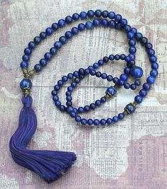 Mala necklace made ​​of, 6 and 8 mm - 0.236 and 0.315 inch, beautiful lapis lazuli gemstones. Together they count as 108 beads. The mala is decorated with metal beads and larger lapis lazuli gemstones - look4treasures on Etsy
