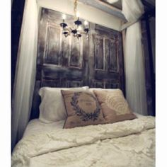 A different version of a wooden headboard which uses whitewashed doors