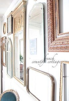 a gallery wall of vintage frames and mirrors, home decor