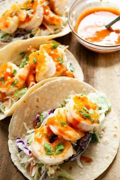 Only 20 minutes stands between you and these sweet and spicy shrimp tacos with a creamy cilantro slaw! Bang bang shrimp tacos are an easy and healthy midweek meal that's also gluten free and dairy free! Sweet And Spicy Shrimp, Spicy Shrimp Tacos, Shrimp Taco Recipes, Shrimp Recipes For Dinner, Mexican Food Recipes, Shrimp Pita Recipe, Easy Weeknight Meals, Easy Dinners, Midweek Meals