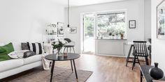 Get the look: salón escandinavo en blanco, negro y verde.