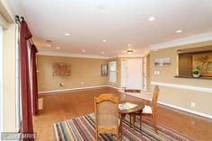 6607 Netties Lane #1607, Alexandria, VA 22315 — Paradise found at Island Creek! Tranquil setting & secluded bkyrd make this light-filled, 2 BR, 2 BTH home an urban oasis. Open LR/DR combo w/gas FP, crown molding, recessed lighting & wd firs throughout. Spacious Kitchen boasts granite counters, custom cabinet inserts, under counter lighting. Community offers: pools, tennis, volleyball, clubhouse, playgrounds.