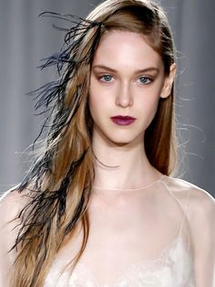 Feathery hair - Marchesa NYFW S/S 2014 Ostrich feathers glued to elastic bands and secured to the model's hair