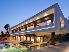 The stunning exterior cuts a striking angular silhouette against the Spanish sky.