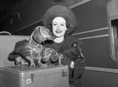 The one and only Joan Crawford  - complete with a darling pair of Dachshunds - in 1940.