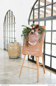 Wooden welcome wedding board with floral details | Venue: Bordeaux Game Farm | Photographers: Louise Vorster Photography | Stationery: Lieflingkind Design | Flowers: Bloom Floral Design |