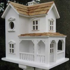 The Outdoor Accents Prairie Farmhouse Bird House is a fully functioning, decorative nest box with a hole for small birds. Wooden Bird Houses, Decorative Bird Houses, Decorative Objects, Farmhouse Birdhouses, Rocking Chair Porch, Door Molding, House Yard, Farm House, Outdoor Living