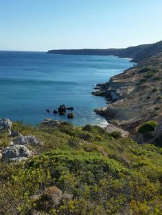 Hiking along coast in Salema, Portugal