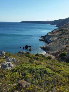 Hiking along coast in Salema, Portugal