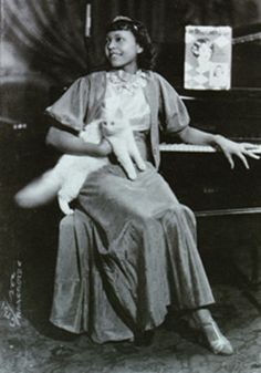 I like this because it looks like the last costume Berniece would wear. African American lady and her cat. 1930s
