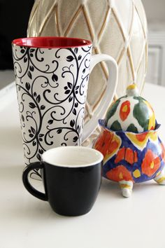I love the graphic on the white with black mug.