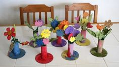 CARDBOARD FLOWERS: For vase, glue toilet roll tube to a cardboard circle. Put a rolled up strip of corrugated cardboard inside the tube. Cut out tons of cardboard leaf and flower shapes. Have kids paint the vases, leaves & flowers then thread the them onto green pipe cleaners and arranged them in the vases. If flowers are too large the pipe cleaners can't support them.