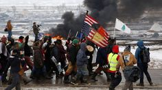 In North Dakota, the main resistance camp set up by Lakota water protectors fighting the $3.8 billion Dakota Access pipeline has been largely vacated after protesters were ordered to leave the camp on Wednesday. Police arrested around 10 people. The U.S. Army Corps of Engineers and the North Dakota governor had imposed a noon eviction deadline for the hundreds of water protectors still living at the resistance camp. Prayers ceremonies were held on Wednesday, and part of the camp was set on…