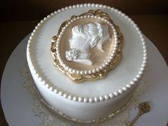 Cameo is gumpaste. Cake is vanilla with caramel buttercream. TFL!