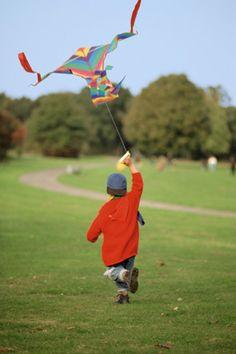 Boy flying kite