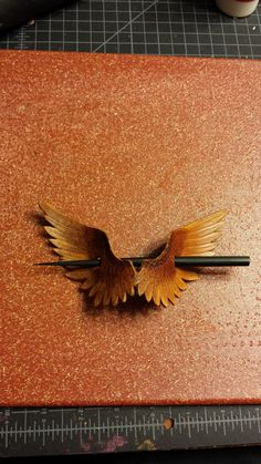 Wings Leather Hair Ornament with Stick Made to by BoondockStudios, $30.00-SR. I love the wings!