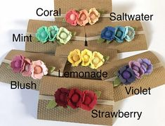 """This listing is for one wool blend flower headband. The 3 flowers are accented with Fern green leaves. The flower and leaves measure approximately 3.5"""" x 1.25. Measurements of the flower and leaves may vary slightly due to each flower being handmade. The flowers are attached to a nylon"""