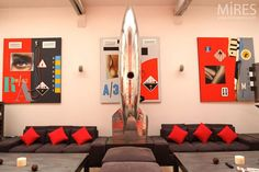 Choose the Best Loft Decorating Ideas: Excellent Futuristic Loft Decorating Ideas With Metal Spaceship Sculpture And Red Black Wall Art In Paris Loft Also Black Sofa Red Cushions Along With Coffee Tables Design Inspirations ~ wiligear.com Decoration Inspiration