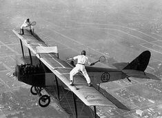 Ivan Unger and Gladys Roy playing tennis on the wings of a flying airplane in 1927