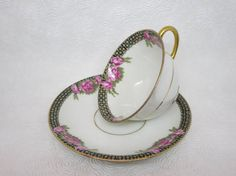 Exquisite Limoges fine porcelain tea cup and saucer Lovely original pattern of roses and dots on white porcelain, gilded with gold Elite Works S M by Bawo & Dotter The red backstamp on this porcelain was used between 1900 and 1914 (Reference: Kovels) A rare and highly collectible item! Made in France Good condition 175 g. Cup : 2 in. Saucer : 5.5 in. ****TODAY DISCOUNT CODE ! VISIT OUR HOME PAGE !*** https://www.etsy.com/ca/shop/LesCurieux?ref=hdr_shop_me...