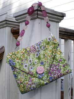 """Free tutorial and pattern for fat quarter Origami Purse and beaded strap tutorial included. The beaded strap is what """"makes"""" this purse. I love her fabric and the button embellishment on the front. This would work nicely for even an afternoon wedding."""