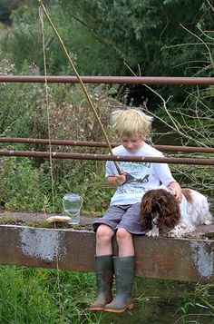 Runner up, Man's best friend category: Clare Chick  Clare is an amateur photographer who was inspired to take a nostalgic picture of a boy and his dog after the London riots. The dog is her pet Meg, a working cocker spaniel. She is a Pets As Therapy dog as well as being Clare's model