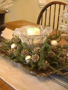 Simple natural tablescape - take one cut glass bowl, cut greens off trees, add pinecones or holly twigs on a silver tray. Add flameless candle VOILA