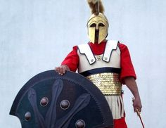 A+Spartan+hoplite+(footsoldier)+donned+a+helmet,+breastplate+and+greaves+and+carried+a+short+sword+at+his+waist.+He+held+so+large+a+shield+that+it+could+be+used+as+a+stretcher+to+carry+wounded+fromthe...