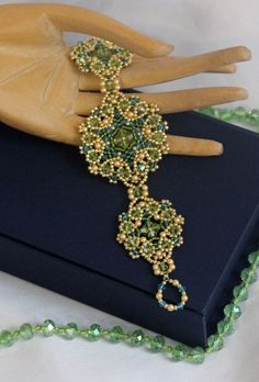 The cat ate favorite))) (added full scheme) bicones 4 mm. Pearls 3 mm. , Faceted beads 2 mm. , Beads - 11 and Toho Toho 15