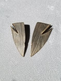 Sterling silver and gold earrings by artist Eleanor Moty. Available at Studio Jewelers. University Of Wisconsin, Handcrafted Jewelry, Bridal Jewelry, Jewelry Crafts, Gold Earrings, Wings, Pendants, Brooch, Jewels