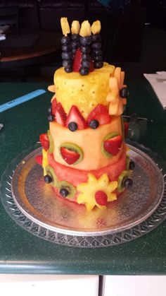 I made a #cake made of fruit for miss Sheila's birthday. #strawberries #blueberries #pineapple #kiwi #yum