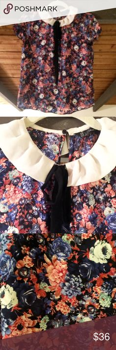 Soft collar tie neck printed blouse Short sleeve floral printed blouse. Has contrast white soft pleated collar and solid black bow neck detail. Keyhole button at back neck for closure. Zara Tops Blouses