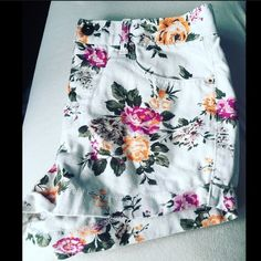 brand New-White Floral Print Denim Short White Floral Print Denim Short. Has two back pockets and two front pockets. Has 4 buttons and can be wore with a belt. Size 28. Brand new with tag Shorts Jean Shorts