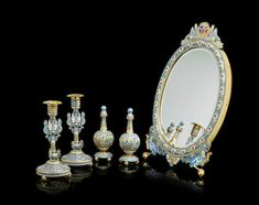 AN IMPORTANT SILVER GILT AND ENAMEL DRESSING TABLE SET IN THE RUSSIAN STYLE Ovchinnikov, Moscow, 1889.