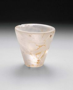 "Opening of the Mouth cup. Quartz crystal. Old Kingdom, 4th Dynasty, Service of Nesi (Pharaoh) Khufu 2551–2528 B.C.E. Cracked conical cup with a small nick out of the upper rim and spots of yellow-brown on the side and base. This ritual cup was used in the ""opening of the mouth"" ceremony performed on the statues of Nesi (Pharaoh) Menkaure in his Valley Temple. 