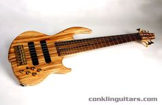 Custom Shop Zebrawood top Sidewinder 7 string bass