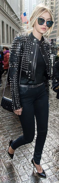Gigi Hadid street style: a studded leather jacket, Chanel purse and mirrored sunglasses