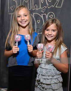 Television personalities Maddie Ziegler (L) and Mackenzie Ziegler attend the 'Dance Moms' meet and greet benefiting Starlight Children's Foundation at Stoopher & Boots on September 29, 2012 in New York City.