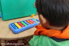 Learn about the sense of hearing by playing Montessori-inspired music games on the glockenspiel #music #handsonlearning #fivesenses || Gift of Curiosity