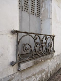 French style! Always better! Use the wrought iron to the side of the patio door.