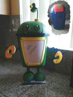 Team Umizoomi bot from a dry erase and small bucket found at the Dollar Tree.