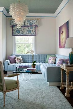 Eddie Lee, Guest Living Room Designer Eddie Lee's living room is tucked away in the guest wing. A blue L-shaped sofa runs nearly the entire width of the space. Offering total tranquility, the room enjoys poolside views and boasts a bright pastel palette. Small Living Rooms, Home Living Room, Living Spaces, Living Area, Cocina Shabby Chic, My New Room, Family Room, Room Decor, House Design