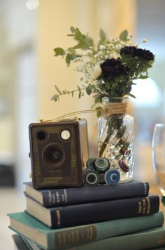 Vintage books are a unique, romantic decor idea. Look for books in the shades of your wedding color to tie everything together. #weddingdecor #blueweddings