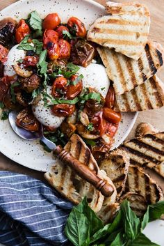 Braised Tomatoes with Burrata | Nothing compares with the sweet flavor of vine ripened cherry tomatoes except vine ripened cherry tomatoes that are braised and served warm over creamy burrata.