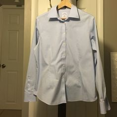 Brooks Brothers fitted non-iron button down Brooks Brothers fitted non-iron button down. Flattering slim cut. Never wrinkles. EUC. Brooks Brothers Tops Button Down Shirts